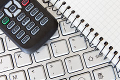 Keyboard with phone and  notebook Royalty Free Stock Photo