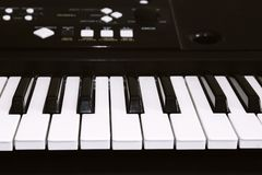 Keyboard or piano for digital music recording, a music instrument background, music concept. A photo of old used synthesizer, elec Royalty Free Stock Photography