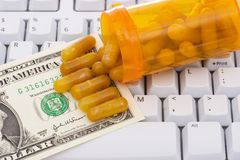 Keyboard with  pills and money Stock Images
