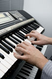 The Keyboard Player. Man playing a synthesizer keyboard Royalty Free Stock Image