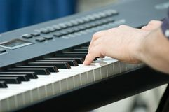 Keyboard player. Hands on keyboard Stock Photo