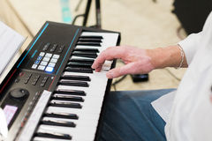 Keyboard player performing on stage Stock Images