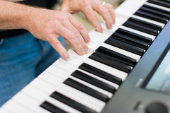 Keyboard player performing on stage Royalty Free Stock Photo