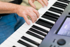 Keyboard player performing on stage Royalty Free Stock Image
