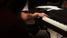 Keyboard player playing on electric piano stock footage
