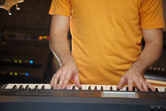 Keyboard player is working in studio Royalty Free Stock Photos