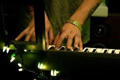 Keyboard playing royalty free stock photo