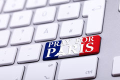 Keyboard with pray for paris text on national France flag Stock Images