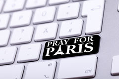 Keyboard with pray for paris text and symbol Royalty Free Stock Photography