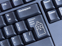 Keyboard with printed image of Santa and inscription happy new year Royalty Free Stock Photo