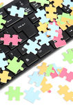 Keyboard and puzzle Royalty Free Stock Photo