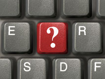 Keyboard with question key. Computer keyboard (close-up) with red question key Stock Image