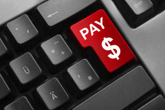 Keyboard red button pay dollar symbol Stock Photography