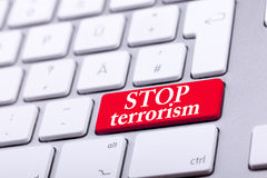 Keyboard with red button and stop terrorism word on it Royalty Free Stock Photography