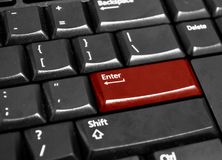 Keyboard with red Enter key. In close up Royalty Free Stock Image