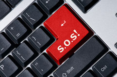 Keyboard with red key S.O.S.!. Personal computer keyboard with red key S.O.S Stock Photo