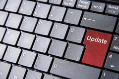 Keyboard with a red uptade key. A close up to a laptop keyboard with a red uptade key instead of enter key Stock Photography