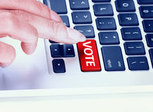 Keyboard with red vote key, business concept Royalty Free Stock Photos