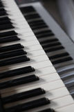 Keyboard of an retro piano. Two rows musical keyboard of an old piano Stock Photography