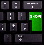 Keyboard shop. Keyboard with green enter button spelling shop Stock Image