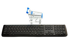 Keyboard and a shopping cart Royalty Free Stock Photos
