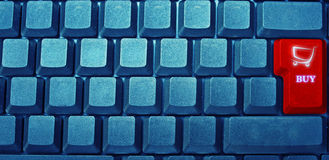 Keyboard shopping cart button. Blank blue keyboard with red shopping trolley, buy, button Royalty Free Stock Image