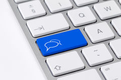 Keyboard with single blue button showing chat icon Stock Photo