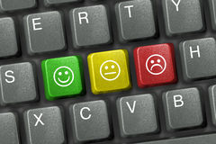 Keyboard with smiley keys Stock Photos