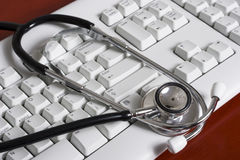 Keyboard with a stethoscope Royalty Free Stock Image