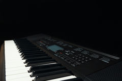 Keyboard of the synth on black background Royalty Free Stock Photography