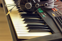 Keyboard synth with headphones Royalty Free Stock Images
