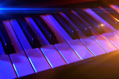 Keyboard synthesizer with colorful lights in concert Royalty Free Stock Photo