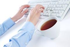 Keyboard and tea Stock Photo