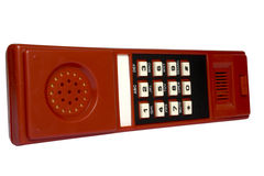Keyboard on a telephone tube. Of red color with white buttons and black figures Stock Image