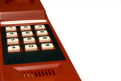 Keyboard on a telephone tube. Of red color with white buttons and black figures Stock Images
