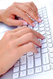 Keyboard Texting. Business Lady texting on a white laptop or computer keyboard Stock Images