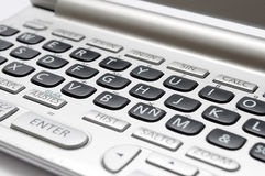 Keyboard translator. Details of a dictionary english to spanish Royalty Free Stock Image