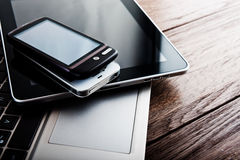 Keyboard with two phones and tablet pc Stock Photography