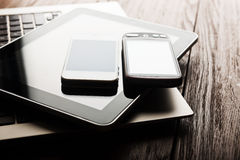 Keyboard with two phones and tablet pc Stock Image