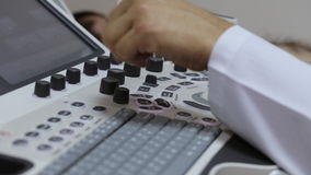 Keyboard ultrasound device close up, doctor`s hand presses buttons stock video