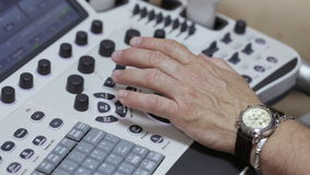 Keyboard ultrasound device close up, doctor`s hand presses buttons. And scanning male patient at hospital stock video footage