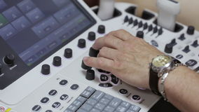 Keyboard ultrasound device close up, doctor`s hand presses buttons stock footage
