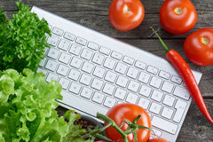Keyboard and vegetables. Online recipe search. Stock Photography