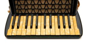Keyboard of vintage 1930s black accordion closeup Royalty Free Stock Photos