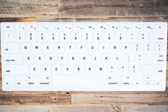 The keyboard on the vintage wooden table top view Stock Photography