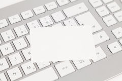 Keyboard and visiting card Stock Images