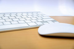 Keyboard and wireless mouse Royalty Free Stock Photos
