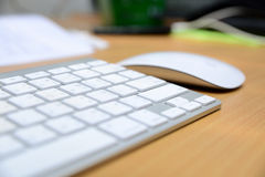 Keyboard and wireless mouse Royalty Free Stock Photography