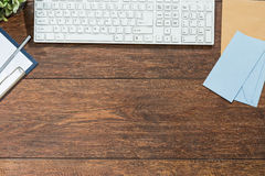 Keyboard on wooden desk Stock Photography