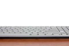 Keyboard on the wooden desk with copy-space Royalty Free Stock Images